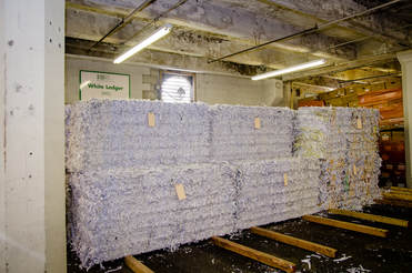 large bales of shredded paper in warehouse
